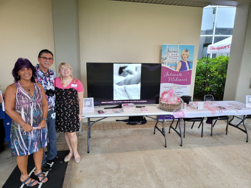 Photo of Dr. Imami, Olivia Magee, and Camille Caglianone at the King Center booth.